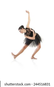 Young beautiful ballet dancer striking a pose isolated on white background