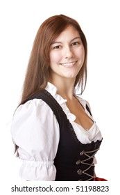 Young beautiful Bavarian woman wearing original Dirndl dress for the Oktoberfest in Munich. Isolated on white background.