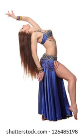 Young beautiful belly dancer in a blue costume