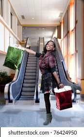 A young beautiful black African American teenage woman on a shopping spree