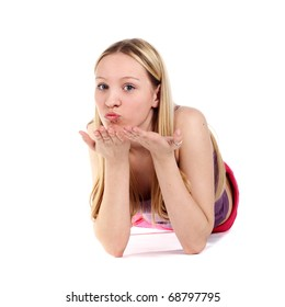 young beautiful blond girl blowing a kiss to somebody