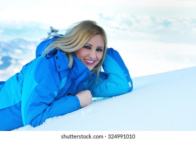 young and beautiful blond is having fun in the snow