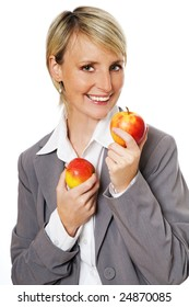 young beautiful blond woman eating apple close up