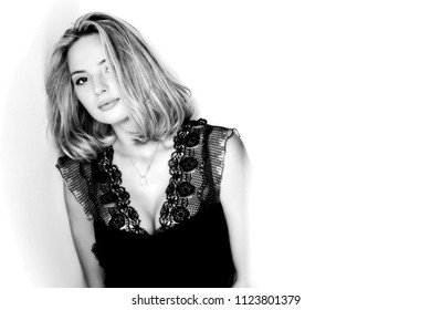 The young beautiful blond woman portrait, studio shot.