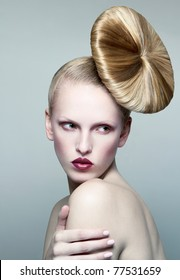 Young beautiful blond woman with styled hair