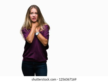 Young beautiful blonde elegant woman over isolated background shouting and suffocate because painful strangle. Health problem. Asphyxiate and suicide concept.