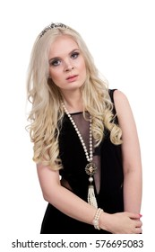 Young beautiful blonde girl in black evening dress isolated on white background