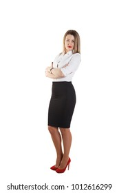Young beautiful blonde girl in business suit stands sideways and looks at the camera, on a white background. Isolate. Space for text. Businesswoman