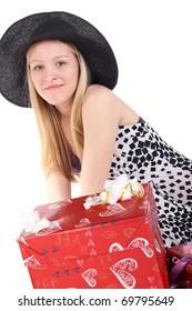 young beautiful blonde girl hear the gift box
