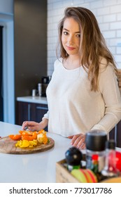 Young beautiful blonde girl in the kitchen