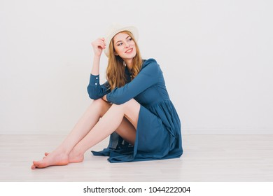 Young beautiful blonde girl posing in Studio on a white background. Toning.