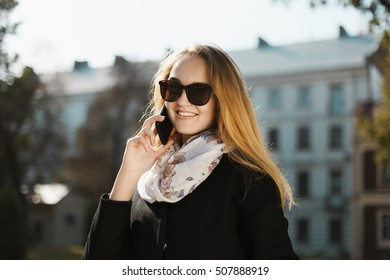 Young Beautiful Blonde Girl in Sunglasses Talking Phone