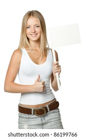 Young beautiful blonde holding blank white flag / board sign and showing thumb up sign over white background