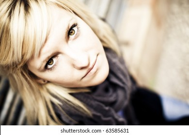 Young beautiful blonde staring at camera from below