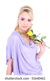 young beautiful blonde with violet make-up and yellow rose