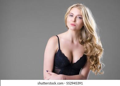 Young beautiful blonde woman in black kombidrese