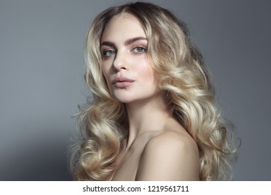 Young beautiful blonde woman with long curly hair