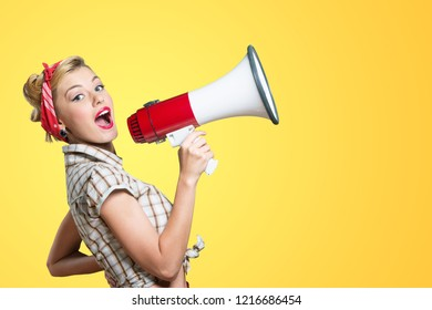 Young beautiful blonde woman with loudspeaker