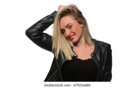 A young beautiful blonde woman playing with her hair. isolated