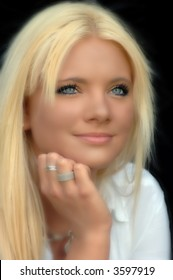 Young beautiful blonde woman. Portrait. Soft, focus is on the eyes.