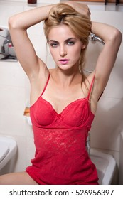 young beautiful blonde woman portrait with natural make up and long hair in lingerie
