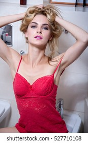young beautiful blonde woman portrait with natural make up and longhair in lingerie