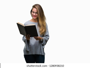 Young beautiful blonde woman reading a book over isolated background with a happy face standing and smiling with a confident smile showing teeth