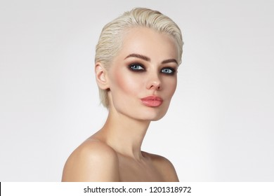 Young beautiful blonde woman with smoky eye makeup, copy space