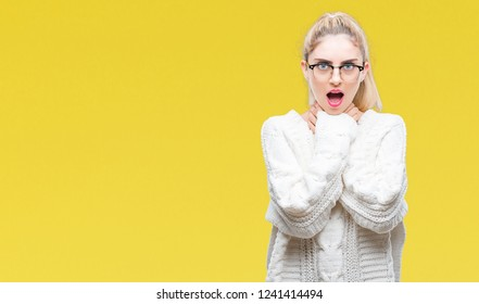 Young beautiful blonde woman wearing glasses over isolated background shouting and suffocate because painful strangle. Health problem. Asphyxiate and suicide concept.