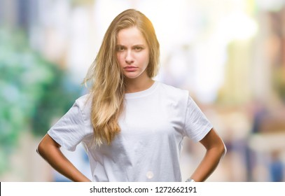 Young beautiful blonde woman wearing casual white t-shirt over isolated background skeptic and nervous, frowning upset because of problem. Negative person.