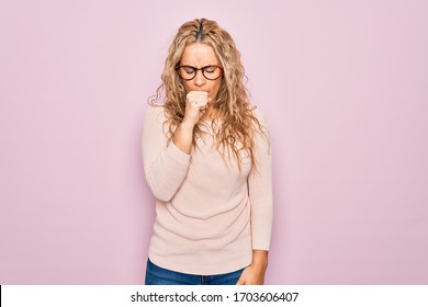 Young beautiful blonde woman wearing casual sweater and glasses over pink background feeling unwell and coughing as symptom for cold or bronchitis. Health care concept.