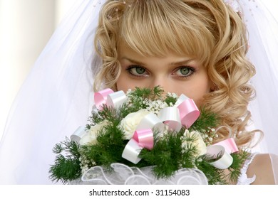 Young beautiful bride with blond hair