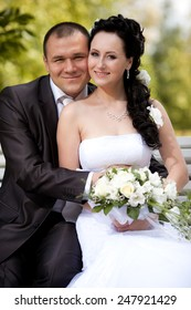 young and beautiful bride and groom in nature