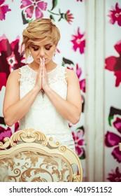 young beautiful bride praying alone