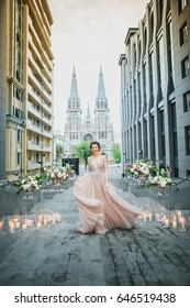 Young, beautiful bride stands on the background of the church