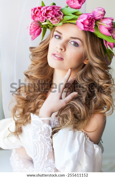 Young beautiful bride with wreath of flowers
