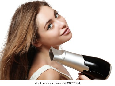 young and beautiful brown-haired woman with long hair natural color and a hairdryer in the hands of