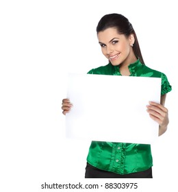 young, beautiful brunette holds a banner isolated on a white background