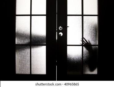 Young beautiful brunette: posing behind the doors