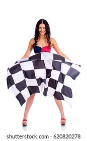 Young beautiful brunette woman in bikini holding a large checkered flag, isolated on white background