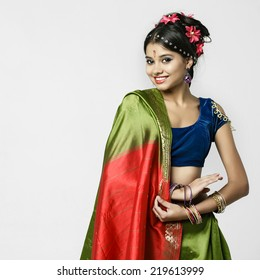 Young beautiful brunette woman in indian green dress
