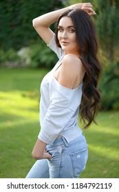 young beautiful brunette woman outdoors