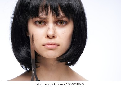 young beautiful brunette woman with scissors
