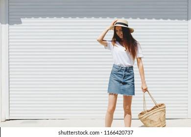 Young beautiful brunette woman wearing blue denim mini skirt 05f7aa794e22