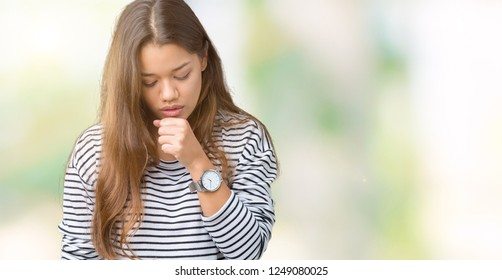Young beautiful brunette woman wearing stripes sweater over isolated background feeling unwell and coughing as symptom for cold or bronchitis. Healthcare concept.