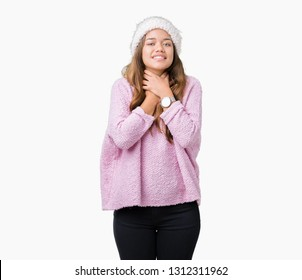 Young beautiful brunette woman wearing sweater and winter hat over isolated background shouting and suffocate because painful strangle. Health problem. Asphyxiate and suicide concept.
