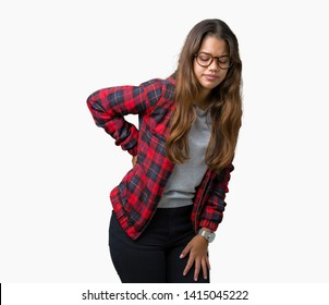 Young beautiful brunette woman wearing jacket and glasses over isolated background Suffering of backache, touching back with hand, muscular pain