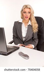Young beautiful business lady having a rest at the working place. sending private message