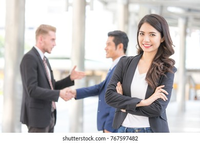 Young Beautiful business woman in city looking out and thinking about work. Young business woman with leader concept. White female thinking about business concept.