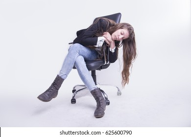 Young beautiful business woman fallen asleep in her office chair, white background, full length